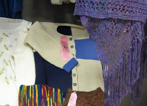 Jacket with ribbon in state fair display case