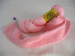 Hank of pink yarn and a bit of garter stitch