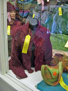 Aran Wrap Cardigan in display case.