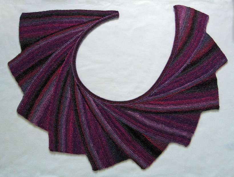 Wingspan shawl in magenta, gray, and black yarn.