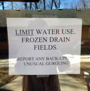 Warning sign about frozen drains.