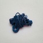 A bit of yarn.