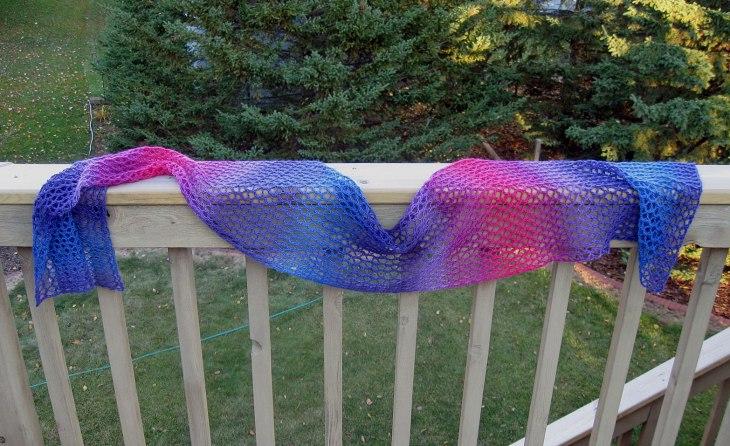 Lupine Scarf draped on a railing.