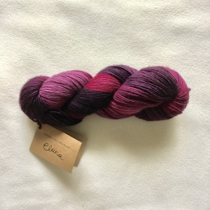 A hank of Manos del Uruguay's Clara yarn in the Velvet colorway.
