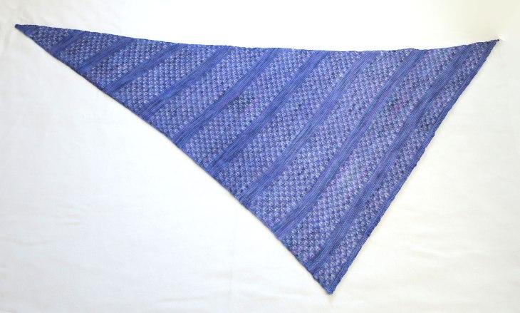 Triangular purple lacy shawl.