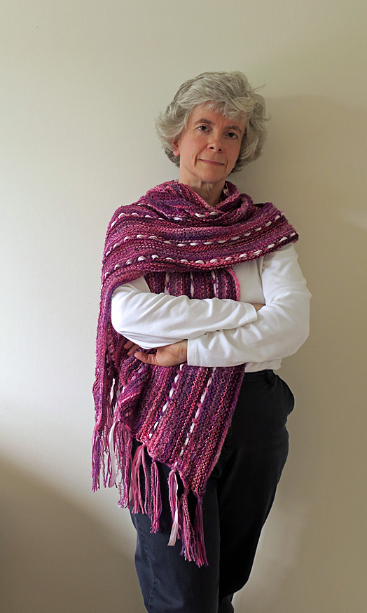 Woman wearing a purple and pink wrap.